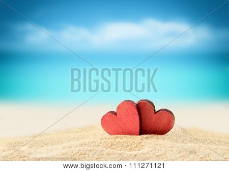 Two hearts on the summer beach