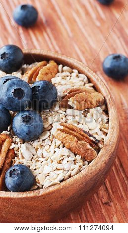 oat meal with walnuts and blueberries selective focus