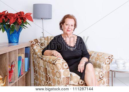 Gracious Senior Woman Relaxing At Home