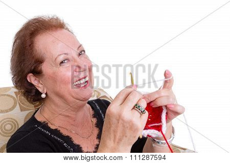 Laughing Senior Lady Sitting Knitting