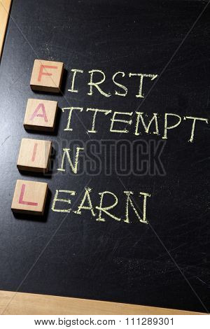 Business Acronym FAIL as first attempt in learn on blackboard. motivational concept image
