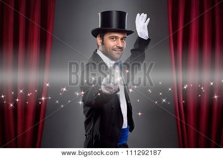 Magician  in costume showing spectacular trick