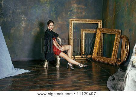 beauty rich brunette woman in luxury interior near empty frames, vintage elegance hispanic