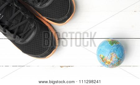 Running Shoes And Earth Ball