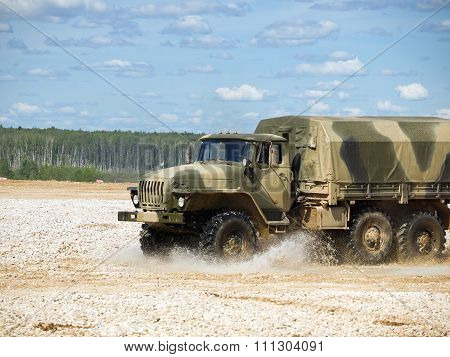 Military truck Ural 4320 enters into the mud with water