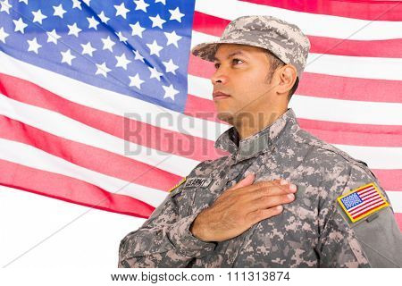 handsome american patriotic soldier with usa flag on background