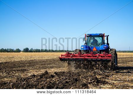 Tractor Work The Land On A Farm