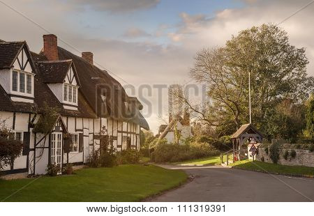 Tudor cottages, Welford on Avon village, Warwickshire, England. poster