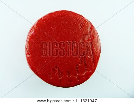 red wax on white background organic natural bright official