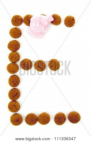 Ginger Nuts, Pepernoten, In The Shape Of Letter E Isolated On White Background