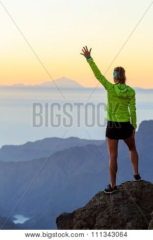 Woman Hiking Success In Mountains Sunset