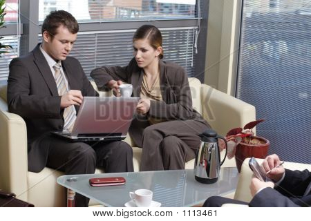 Working Business People Sitting In The Office And Talking