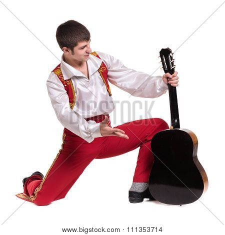 Dancing man wearing a toreador costume with guitar. Isolated on white in full length.