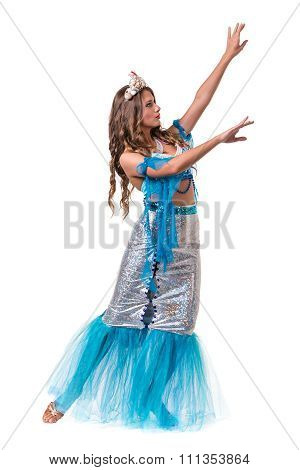 Carnival dancer girl dressed as a mermaid posing, isolated on white