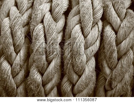 Close-up Of An Old Frayed Boat Rope As A Nautical Background. Sepia
