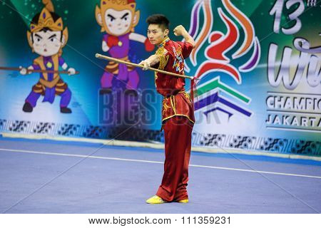 JAKARTA, INDONESIA - NOVEMBER 17, 2015: Jason Chen-Leung of Macao performs the movements in the men's Qiangshu event at the 13th World Wushu Championship 2015 at the Istora Senayan Stadium.