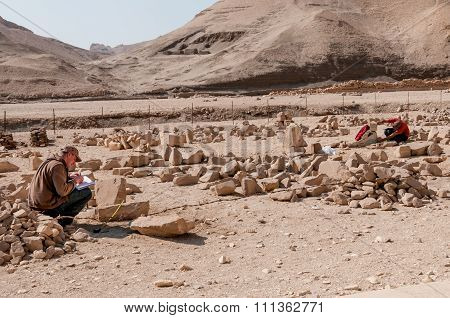 Archaeologists West Bank Of Nile Near Luxor.