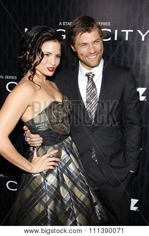 HOLLYWOOD, USA - MARCH 20: Liam McIntyre and Katrina Law at the Los Angeles Premiere of