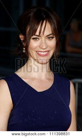 HOLLYWOOD, CALIFORNIA - Tuesday August 30, 2011. Maggie Siff at the Season 4 premiere of FX Network's