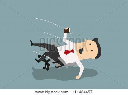 Businessman in an office chair falls backwards