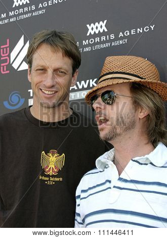 David Spade and Tony Hawk at the Standup For Skateparks benefit held at Pinz Bowling Alley in Studio City, California on October 3, 2004.