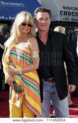 WESTWOOD, CALIFORNIA. October 9, 2005. Goldie Hawn and Kurt Russell at the DreamWorks Pictures Premiere of 'Dreamer' at the Mann Village Theatre in Westwood, California United States.