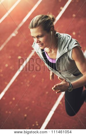 Close-up Of Athletic Young Woman Running Fast On Stadium