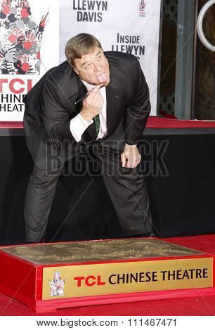 John Goodman at the John Goodman Handprint and Footprint Ceremony held at the TCL Chinese Theatre in Los Angeles on November 14, 2013.