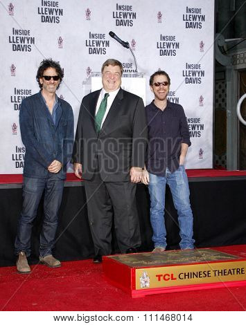 John Goodman, Ethan and Joel Coen at the John Goodman Handprint and Footprint Ceremony held at the TCL Chinese Theatre in Los Angeles on November 14, 2013.