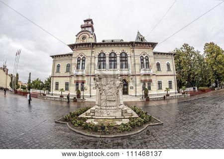 TARGU-JIU, ROMANIA-OCTOBER 08: Gorj Prefecture and the monument of Ecaterina Teodoroiu
