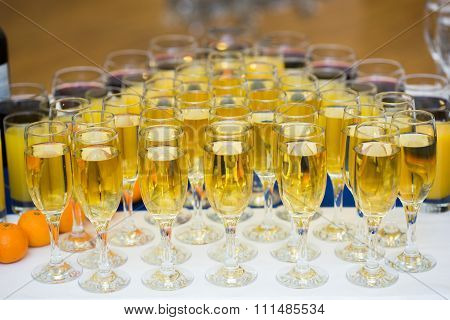 Glasses with champagne on the party table. lot of alcohol