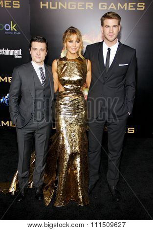 Josh Hutcherson, Jennifer Lawrence and Liam Hemsworth at the Los Angeles premiere of 'The Hunger Games' held at the Nokia Theatre L.A. Live in Los Angeles on March 12, 2012.