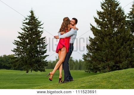 Couple in love passionately hugging.