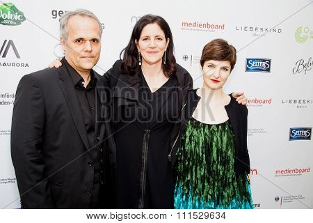 Dirk Wilutzky, Laura Poitras and Mathilde Bonnefoy at the German Oscar nominees reception held at Villa Aurora in Pacific Palisades on February 21, 2015.