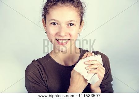 Child Hygiene.Little girl cleaning her hands with a wet baby wipe isolated on a white background.