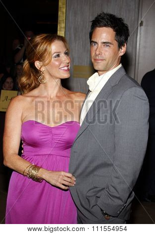 Adam Kaufman and Poppy Montgomery at the Operation Smile's 8th Annual Smile Gala held at the Beverly Hilton Hotel in Beverly Hills, USA on October 2, 2009.