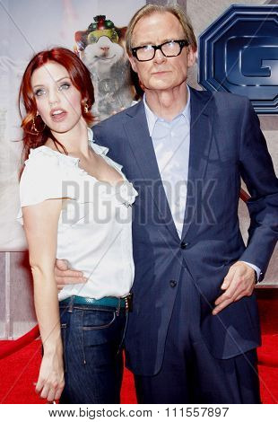 Kelli Garner and Bill Nighy at the World premiere of 'G-Force' held at the El Capitan Theater in Hollywood, USA on July 19, 2009.