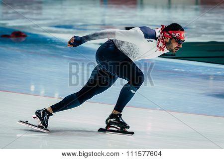 brutal man athlete speedskater warming up before race sprint distance