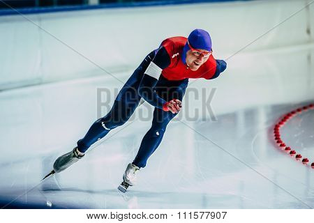 closeup young athlete skater during race sprint distance along path of ice Palace