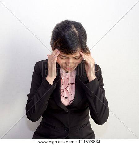 A Woman With Headache, Migraine, Stress, Hangover In Business Executive Dress, Office Syndrome Conce