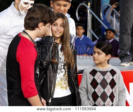 HOLLYWOOD, CA - JANUARY 26, 2012: Prince Michael Jackson, Blanket Jackson, and Paris Jackson at the Michael Jackson Immortalized held at the Grauman's Chinese Theatre in Los Angeles.