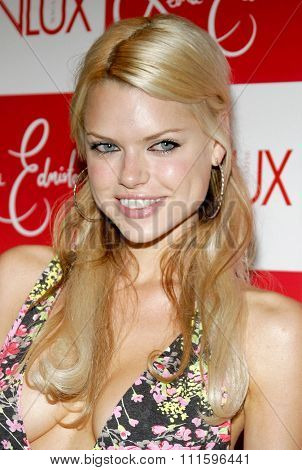 Sophie Monk attends the Leona Edmiston Frock Gallery Opening held at the Frock Boutique On Sunset Strip in West Hollywood, California on March 14, 2006.