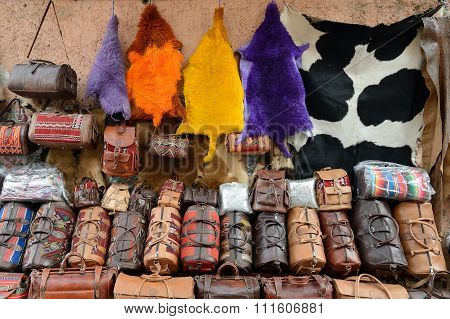 Leather ware on the souk (market) in the old town Medina in Morocco poster