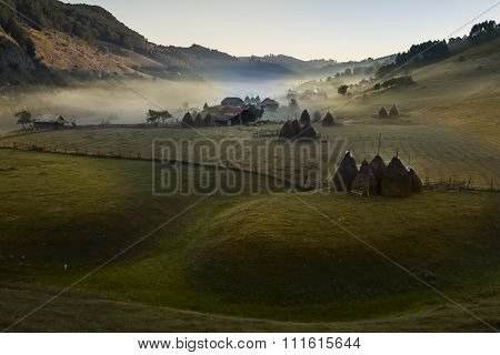 Mountain landscape with morning fog at sunrise - Fundatura Ponorului,Hunedoara county, Romania