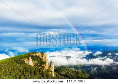 Rainbow over the mountain,Ceahlau massif, Eastern Carpathians, Moldova, Romania
