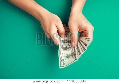 Counting money with hands