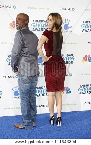 LOS ANGELES, CALIFORNIA - December 7, 2012. Maria Menounos and Darius Rucker at the 2nd Annual American Giving Awards held at the Pasadena Civic Auditorium in Los Angeles.