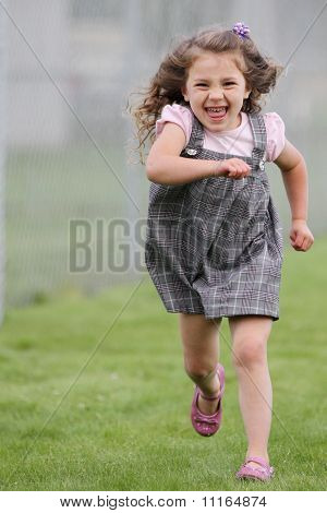 Girl running towards camera in skirt