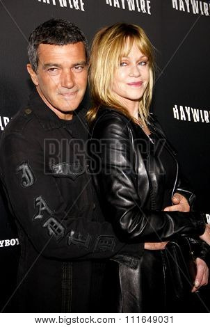HOLLYWOOD, CALIFORNIA - January 5, 2012. Antonio Banderas and Melanie Griffith at the Los Angeles premiere of