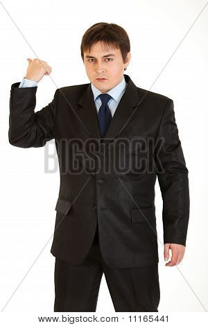 Angry businessman showing get out gesture isolated on white